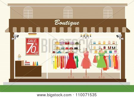 Clothing Store Building And Interior With Products On Shelves.