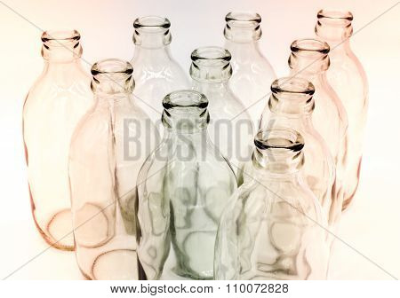 Detail of glass bottles on white background
