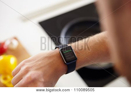 Man Looking At News Application Software On Smart Watch