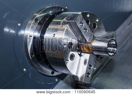 Rotating shiny metal part of the CNC lathe