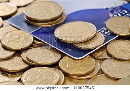 Credit Card Amongst Coins Of Yellow Metal