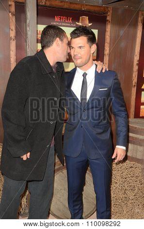 LOS ANGELES - NOV 30:  Adam Sandler, Taylor Lautner at the