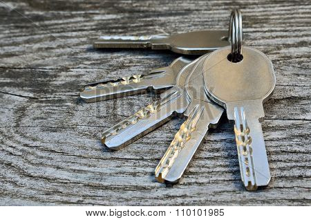 Bunch Of Keys On A Wooden Background, Close-up