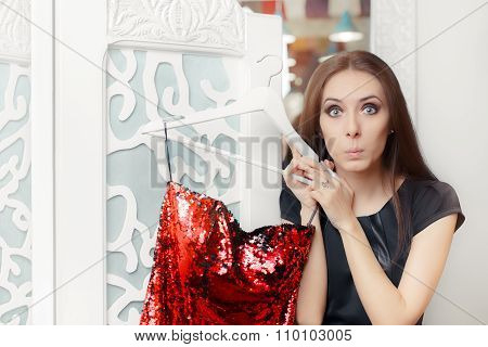 Astonished Girl Trying on Red Party Dress in Dressing Room