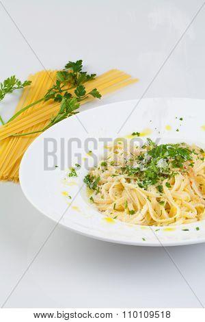 Spaghetti aglio e olio, with garlic, parsley and parmesan cheese.