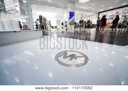 SINGAPORE - NOVEMBER 08, 2015: interior of Michael Kors store. Michael Kors Holdings is a fashion company established in 1981 by American designer Michael Kors