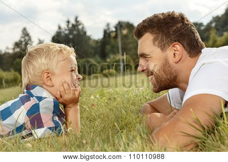 Profile of happy father and son in the park