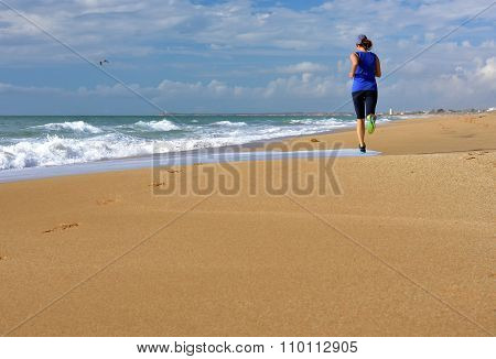 Running Woman Beach Ocean. Copy Space.