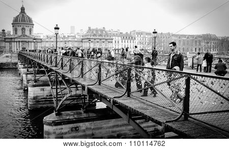 Tourists On The Pont De L'archeveche In Paris In France.
