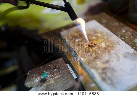 Goldsmith Working On A Ring