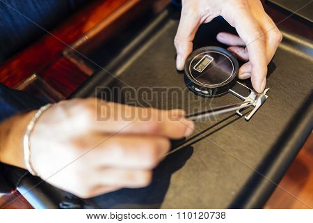 Jeweler Checking Size Of Diamond