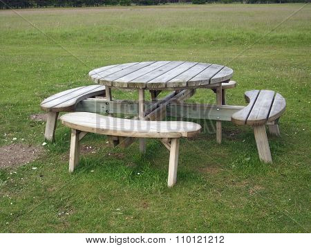 Round wooden picnic table