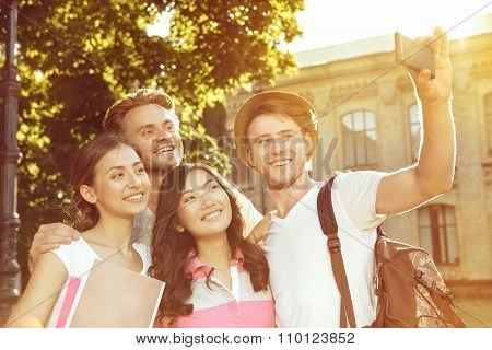 Group of friends doing selfie in the park