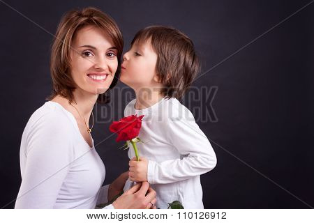 Young Kid Giving Gorgeous Red Rose To His Mom