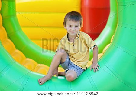 Cute Little Boy, Playing In A Rolling Plastic Cylinder Ring, Full With Air