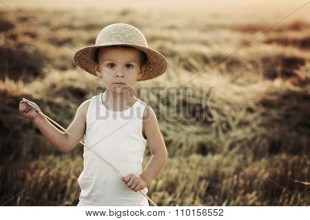 Boy In A Filed With A Hat