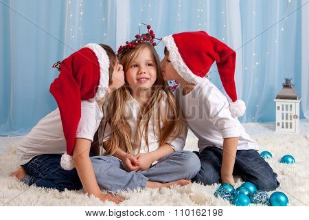 Two Little Twin Brothers, Giving A Kiss To Their Sister, Christmas Concept