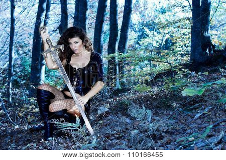 Woman with fantasy sexy dress and sword