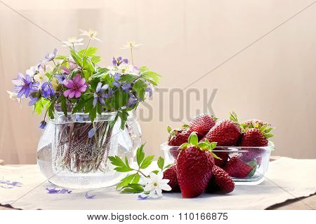 Glass Vase With Fresh Spring Forest Flowers, Bowl With Strawberries And A Few Strawberries, Lying On