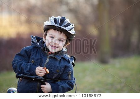 Little Boy With Helmet And Bike, Eating Cake