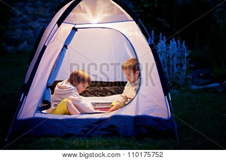 Two Boys In A Tent, Playing Chess