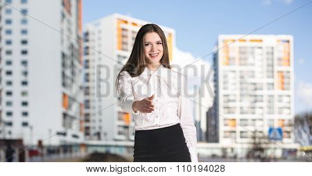 Businesswoman stands on the street