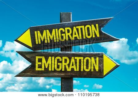Immigration - Emigration signpost with sky background