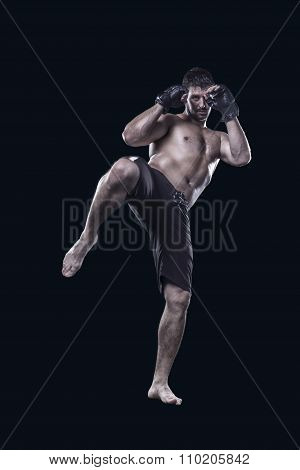 Mixed martial arts fighter kicking with knee isolated