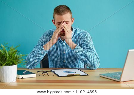 Young Tired Businessman Rubbing His Eyes