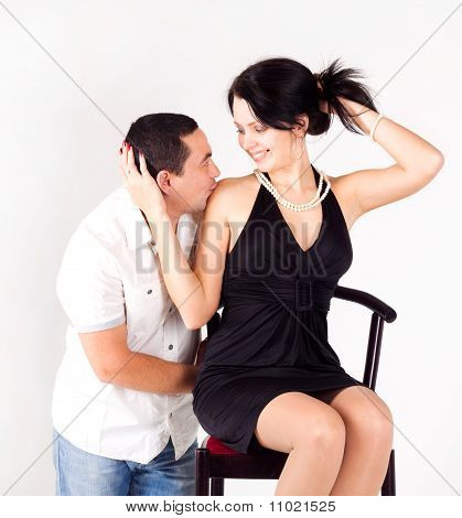 A Man Kissing A Pretty Girl