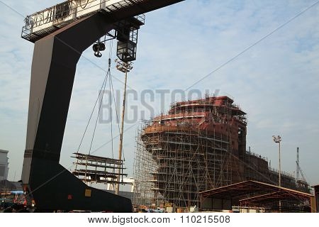 View Of Shipyard With Straddle Crane And Ship Under Construction
