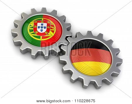 Portuguese and German flags on a gears (clipping path included)