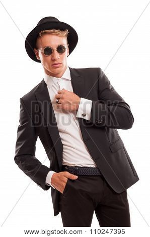 Elegant Male Model Wearing A Fancy Hat And Some Round Sun Glasses.