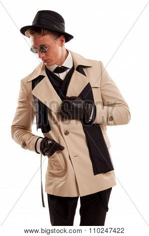 Elegant Detective Posing On A White Background.