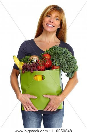 Woman with grocery bag of vegetables isilated on white background.