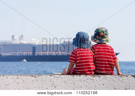 Two Boys, Contemplating A Big Ship In The Sea