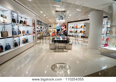 SINGAPORE - NOVEMBER 09, 2015: interior of Michael Kors store in Changi Airport. Michael Kors Holdings is a fashion company established in 1981 by American designer Michael Kors