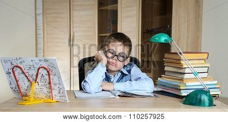 Tired Boy Wearing Funny Glasses Doing Homework. Child With Learning Difficulties. Boy Having Problem