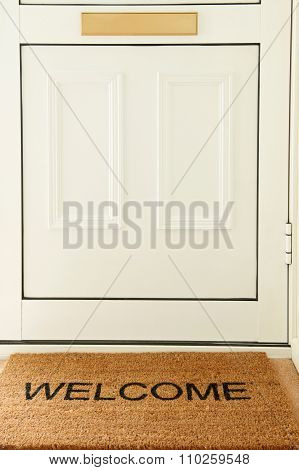 Welcome Mat In Front Of Door To Home