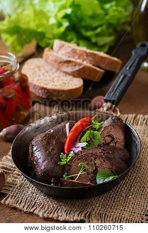 Homemade Blood Sausage With Offal On The Old Wooden Background In Rustic Style