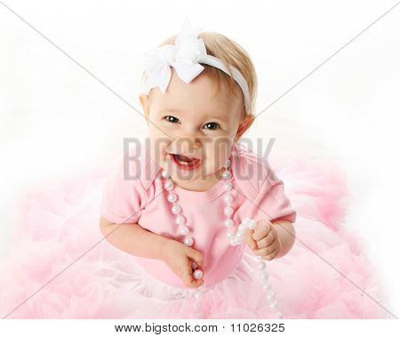 Glimlachende Baby meisje dragen Pettiskirt Tutu en parels