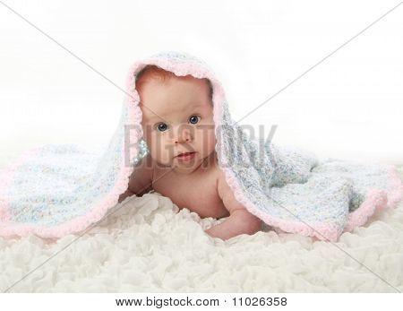 Baby Lying On Tummy Under Blanket