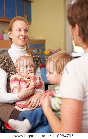 Mothers With Babies Chatting At Playgroup