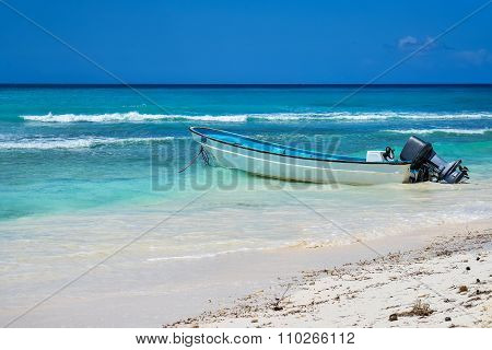 Boat On Tropical Beach At Caribbean Island
