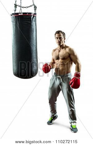 Muscular Boxer Near The Boxing Bag. Isolated On White Background.