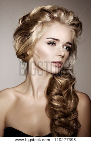 Model with long braided hair. Waves Curls Braid Hairstyle. Hair Salon. Updo. Fashion shiny hair. Woman with healthy hair, girl with luxurious haircut. Hair loss, braiding hair volume.  poster