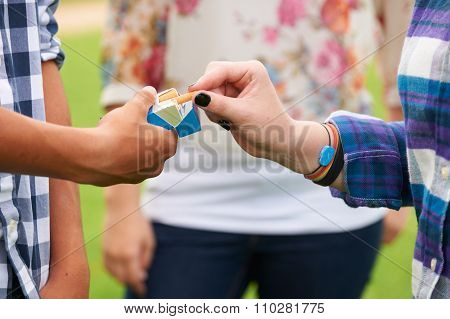 Group Of Teenagers Smoking