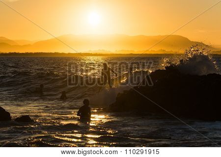 Byron Bay, Australia - Circa May 2014 - Surfer Walking In The Water While Sunset