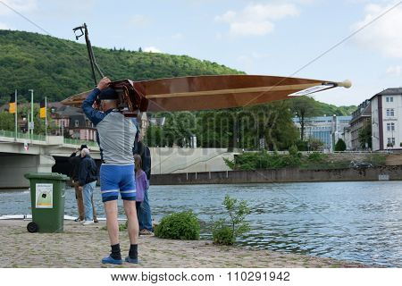 Heidelberg, Germany - Circa May 2013 - A Rower Carrying His Boat Before Entering The Water