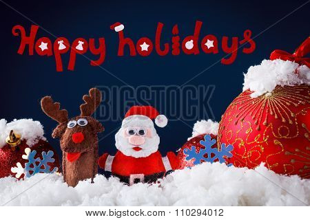 Christmas Santa And Reindeer Toys On Snow With Festive New Year Balls